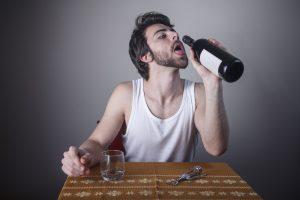alcoholic man with wine
