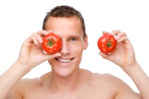 man with 2 tomatoes