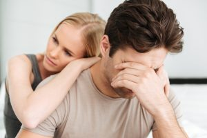 woman comforts depressed man