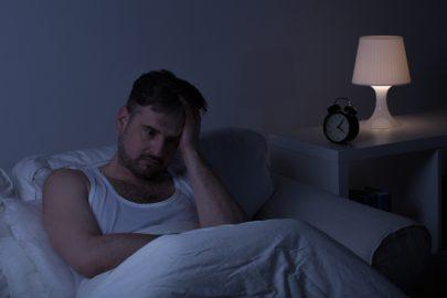 man suffers through insomnia