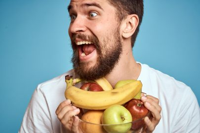 man with bowl of fruits